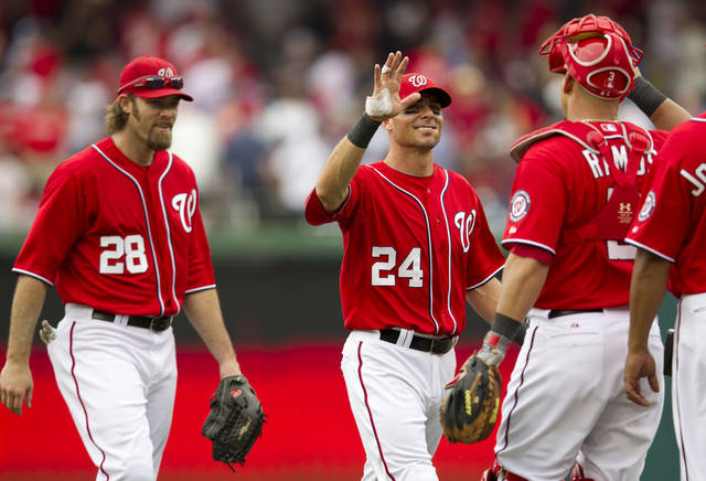 Washington Nationals right fielder Jayson Werth (28), center fielder Rick Ankiel (24) and catcher Wilson Ramos (3) congratulate each others after winning 7-1 in a baseball game against the Philadelphia Phillies in Washington, Saturday, May 5, 2012. (AP Photo Manuel Balce Ceneta)