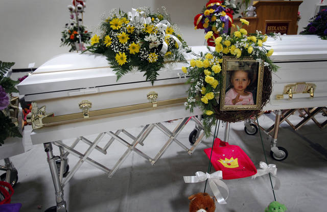 The casket of Evynn Garas during funeral services for Summer Rust and her four children Kirsten Rust, Autumn Rust, Teagin Rust and Evynn Garas in El Reno, Okla. on Wednesday, Jan. 21, 2009. Rust and her children were killed earlier this month in their apartment in El Reno, Okla. 