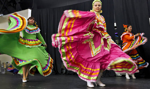Members of Yumare Mexican Folkloric Dancers Inc. perform Wednesday during a benefit dinner for the family of homicide victim Jasmen Gonzalez at John Glenn Elementary School in Oklahoma City. Jasmen was a member of the dance troupe that performed in her honor. Photo by Chris Landsberger, The Oklahoman