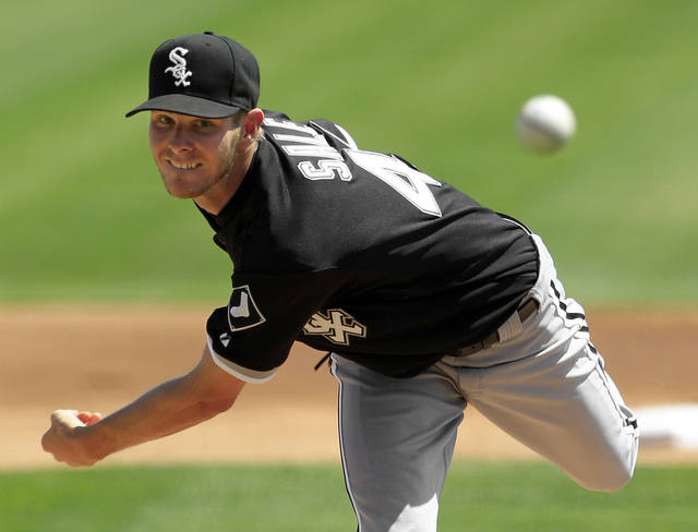Chicago White Sox's Chris Sale pitches against the Los Angeles Dodgers in the first inning of a spring training baseball game on Thursday, March 29, 2012, in Glendale, Ariz. (AP Photo/Mark Duncan)