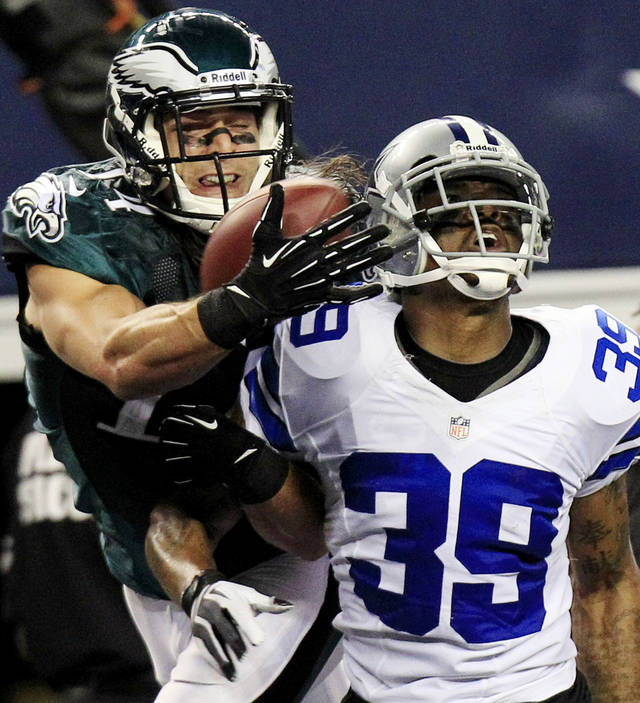 Philadelphia Eagles wide receiver Riley Cooper (14) makes a touchdown reception as Dallas Cowboys cornerback Brandon Carr (39) defends during the second half of an NFL football game, Sunday, Dec. 2, 2012, in Arlington, Texas. (AP Photo/LM Otero)