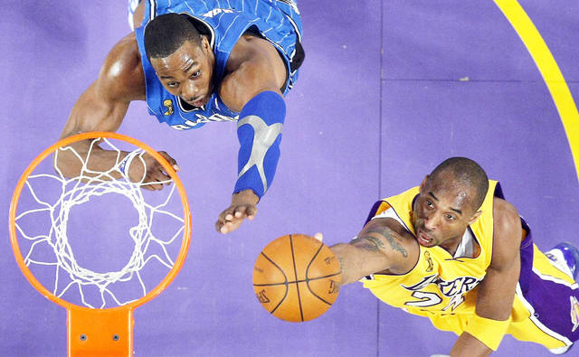 Kobe Bryant, right, and Dwight Howard, left, playing together would shift the balance of power in the West. AP Photo