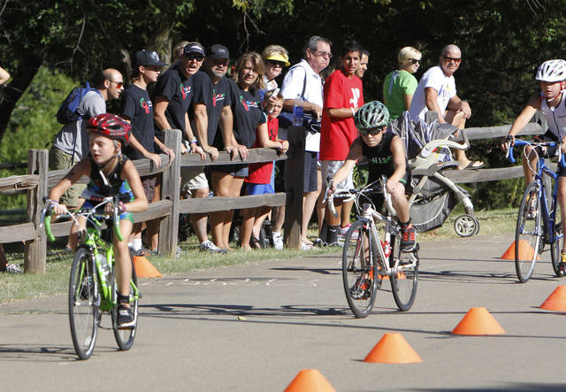9-11 year olds compete in the bicycling event as the YMCA hosts a youth triathlon at Hafer Park and Pelican Bay in Edmond, OK, Saturday, July 21, 2012,  By Paul Hellstern, The Oklahoman