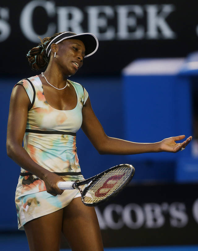 Venus Williams of the US reacts during her third round loss to Russia's Maria Sharapova at the Australian Open tennis championship in Melbourne, Australia, Friday, Jan. 18, 2013. (AP Photo/Dita Alangkara)