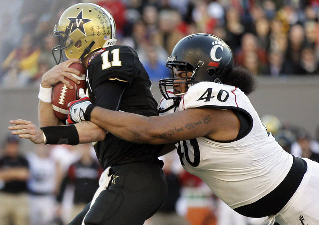 Cincinnati defensive lineman John Hughes (40) brings down Vanderbilt quarterback Jordan Rodgers (11) in the second quarter of the Liberty Bowl NCAA college football game on Saturday, Dec. 31, 2011, in Memphis, Tenn. (AP Photo/Mark Humphrey)