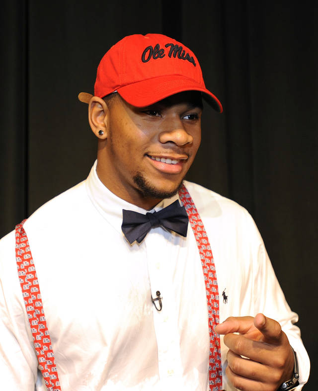 Grayson High School football player Robert Nkemdiche, the nation's top recruit, announces his intent to play college football for Ole Miss during a signing day ceremony at his high school auditorium in Grayson, Ga., Wednesday Feb. 6, 2013. (AP Photo/David Tulis) <strong>Dave Tulis</strong>