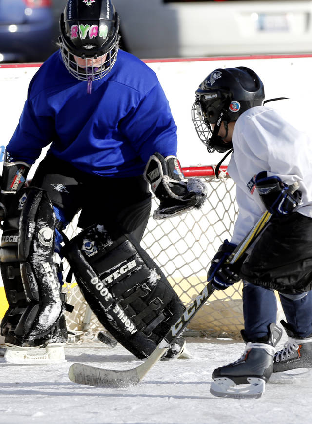 Members of the Oklahoma City Youth Hockey Association&#039;s 8 and under league play at the Norman Outdoor Holiday Ice Rink on Saturday, Dec. 22, 2012 in Norman, Okla. Photo by Steve Sisney, The Oklahoman