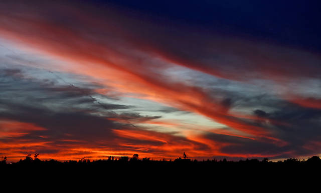 Clouds build around the sunset in the west sky on Monday, Oct. 8, 2012, in Yukon, Oklahoma.  Photo by Chris Landsberger, The Oklahoman