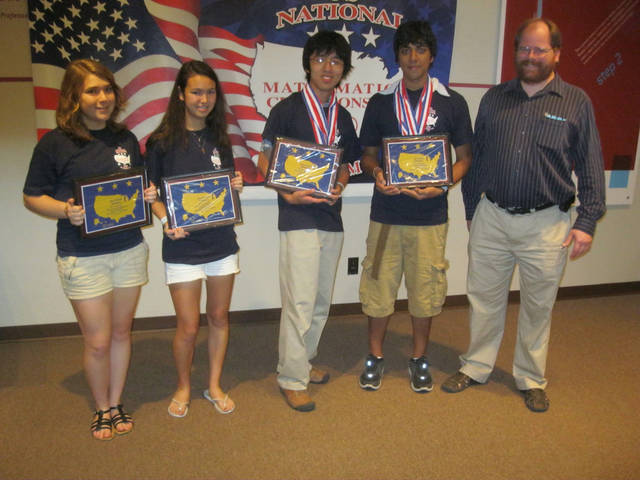 Winners of the recent U.S. National High School Mathematics Championships in Oklahoma City were, from left, Rosalie Mortellaro, Margaret Lee, Mike Wu and Rijul Gupta. At right is Paul Phillips, chairman of the math department at Dallas University, who served as judge. PHOTO PROVIDED