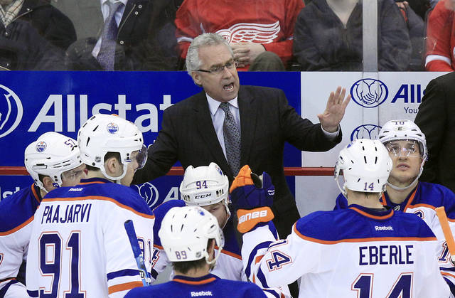 FILE - In this Feb. 8, 2012, file photo, Edmonton Oilers coach Tom Renney talks to his team during an NHL hockey game against the Detroit Red Wings in Detroit. The Oilers are searching for a new coach after deciding to let Renney go following two losing seasons. The team announced on its Twitter feed Thursday, May 17, 2012, that it decided not to renew Renney's contract. (AP Photo/Carlos Osorio, File)
