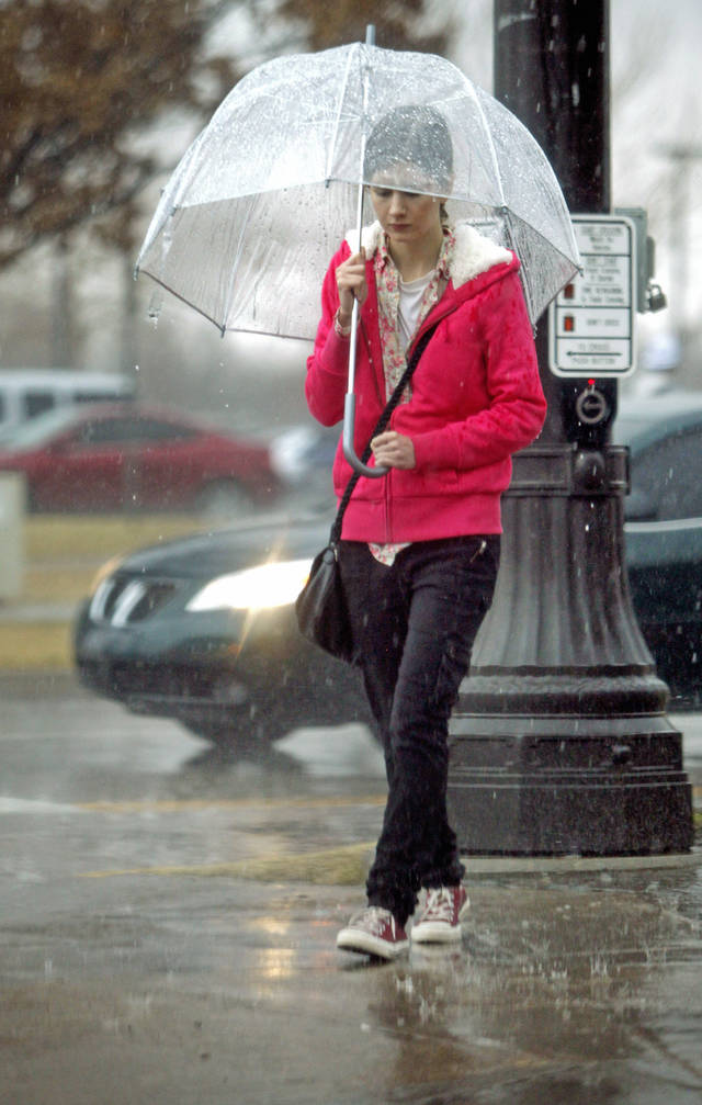 A student walks to class at the University of Oklahoma (OU) as rain passes through the area on Friday, Feb. 3, 2012, in Norman, Okla.  Photo by Steve Sisney, The Oklahoman