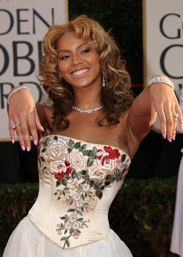 Actress and singer Beyonce Knowles shows off her jewelry as she arrives for the 60th Annual Golden Globe Awards in Beverly Hills, Calif., on Sunday, Jan. 19, 2003. Knowles was a presenter during the telecast. (AP Photo/Mark J. Terrill)