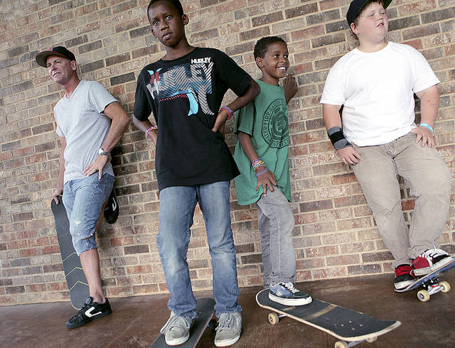 Steve McNutt, left, is with a younger generation of skaters, from left, Aaron  Ward, Moses Ward and Nate Zaloudek, all of Edmond, during a skateboarding demonstration.  PHOTOS BY JOHN CLANTON, THE OKLAHOMAN