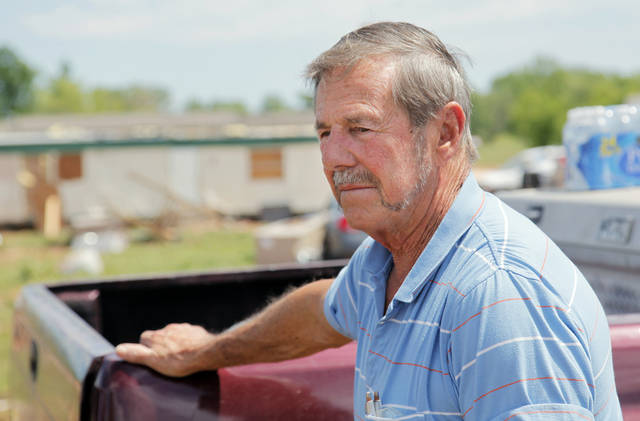Arley Hutchison, owner of the Hide-A-Way Mobile Home Park, takes a break from cleaning up debris at the park in Woodward, Okla., Monday, April 16, 2012.  A tornado struck the town early Sunday morning. Photo by Nate Billings, The Oklahoman