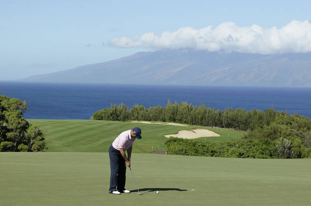 Jonathan Byrd makes a birdie putt on the 13th green during the pro-am event of the Tournament of Champions PGA Tour golf tournament in Kapalua, Hawaii Thursday, Jan. 5, 2012. Byrd is the defending champion of the tournament which is scheduled to being Friday. (AP Photo/Eric Risberg)