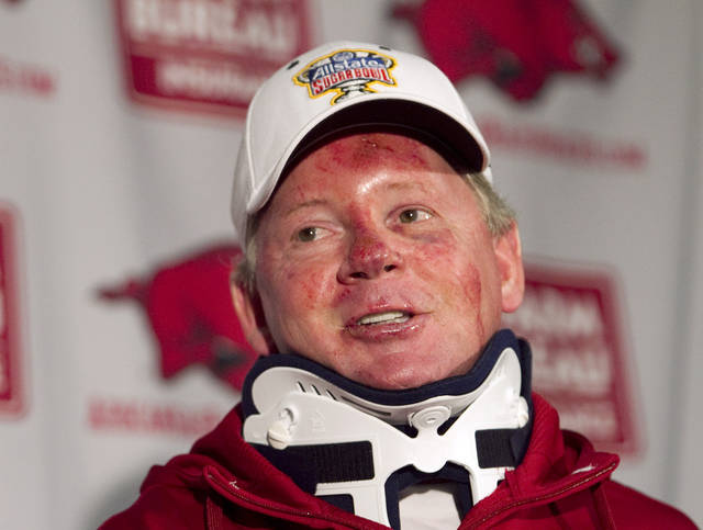 FILE - In this April 3, 2012, file photo, Arkansas football coach Bobby Petrino speaks during a news conference in Fayetteville, Ark., after being released from a hospital after he was injured in a motorcycle accident. A person familiar with the situation says Petrino is out as coach at Arkansas. The person spoke to The Associated Press on the condition of anonymity, and the university has scheduled a Tuesday evening, April 10, 2012, news conference with athletic director Jeff Long. (AP Photo/Gareth Patterson, File)