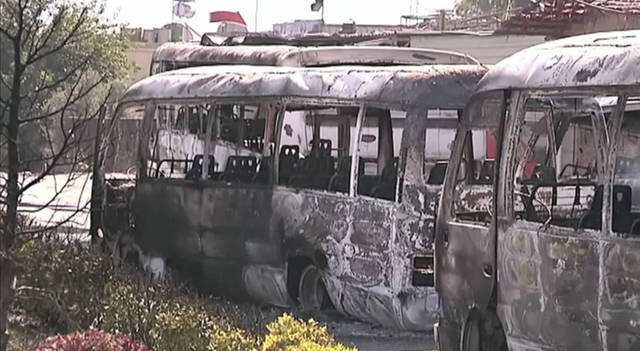 This image made from video released by UNSMIS, the UN observer mission in Syria and accessed Saturday, June 9, 2012, purports to show destroyed buses after overnight fighting in Damascus, Syria. In Damascus, residents spoke about a night of shooting and explosions in the worst violence Syria's capital has seen since the uprising against President Bashar Assad's regime began 15 months ago.(AP Photo/UNSMIS via AP video) THE ASSOCIATED PRESS CANNOT INDEPENDENTLY VERIFY THE CONTENT, DATE, LOCATION OR AUTHENTICITY OF THIS MATERIAL