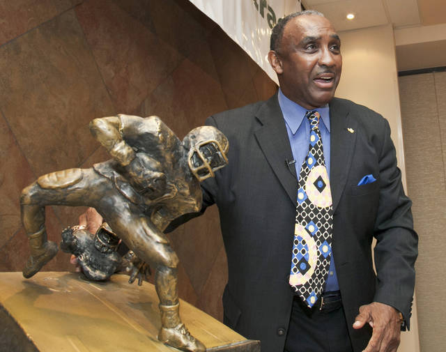 """A new award to honor college football's top return specialist is announced by 1972 Nebraska Heisman Trophy winner Johnny Rodgers, at a news conference in Omaha, Neb., Tuesday, March 27, 2012. The Johnny """"The Jet"""" Rodgers Award is named for Rodgers, who is widely regarded as one of the top punt and kick returners in college football history. The winner for the 2011 season will be selected by Rodgers and announced Thursday. Rodgers said national media members will be enlisted to select future winners. (AP Photo/Nati Harnik)"""