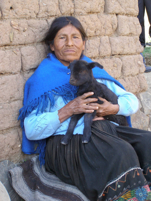 A Bolivian woman rests against a wall in this World Neighbors photo. Efforts in this South American country include managing natural resources, creating women's groups, improving cultivation techniques and promoting family planning and reproductive health. <strong> - World Neighbors</strong>
