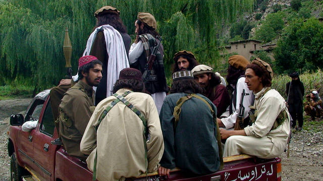 "In this photo taken on Aug. 5, 2012 Pakistani Taliban patrol in their stronghold of Shawal in Pakistani tribal region of South Waziristan. Taliban spokesman Ahsanullah Ahsan told the Associated Press that Taliban threatened to kill a Pakistani cricket star Imran Khan who has become a major political player if he holds a planned march to their tribal stronghold along the Afghan border to protest U.S. drone attacks. Ahsan said ""If he comes, our suicide bombers will target him,"" (AP Photo/ Ishtiaq Mahsud)"