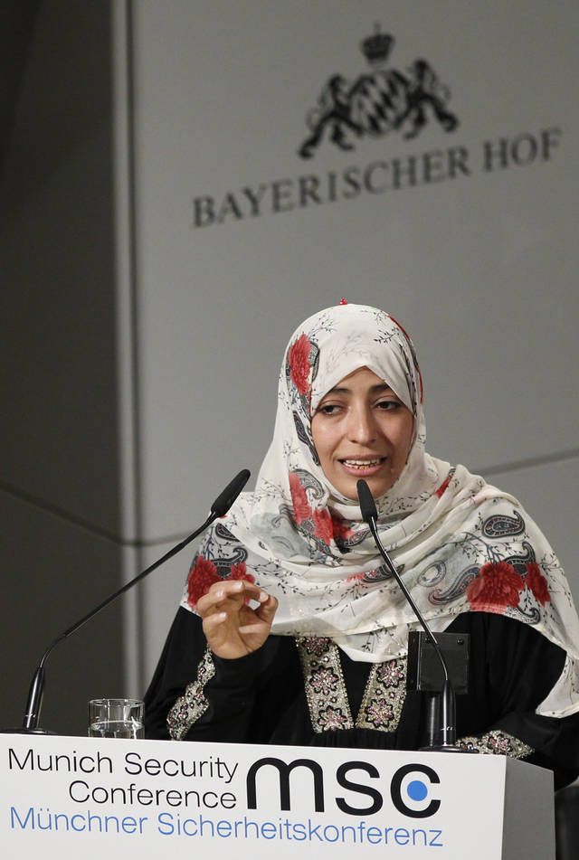 Tawakkul Karman, of Yemen, who won the 2011 Nobel Peace Prize, gestures during her speech at the Security Conference on Sunday, Feb. 5, 2012 in Munich, southern Germany. The Yemeni activist says Russia and China bear moral responsibility for killings in Syria and is urging governments to expel Syrian ambassadors. (AP Photo/Matthias Schrader)