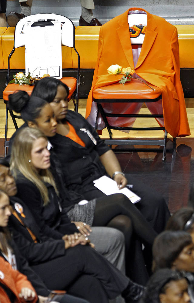 Coach Kurt Budkey's orange blazer hangs from a seat on the sideline during the memorial service for Oklahoma State head basketball coach Kurt Budke and assistant coach Miranda Serna at Gallagher-Iba Arena on Monday, Nov. 21, 2011 in Stillwater, Okla. The two were killed in a plane crash along with former state senator Olin Branstetter and his wife Paula while on a recruiting trip in central Arkansas last Thursday. Photo by Chris Landsberger, The Oklahoman