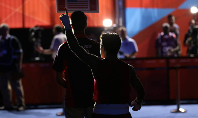USA's Joseph Diaz Jr. reacts as he leaves the ring after defeating Ukraine's Pavlo Ishchenko in a men's bantam 56 kg preliminary boxing match at the 2012 Summer Olympics, Saturday, July 28, 2012, in London. (AP Photo/Patrick Semansky)
