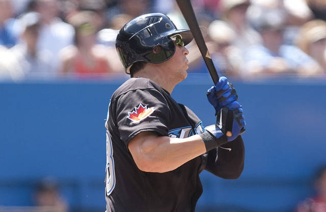 Toronto Blue Jays' Colby Rasmus follows the flight of the ball after hitting a double to deep center off Texas Ranger pitcher C.J Wilson during the fourth inning of a baseball game in Toronto, Sunday July 31, 2011.(AP Photo/The Canadian Press, Chris Young)