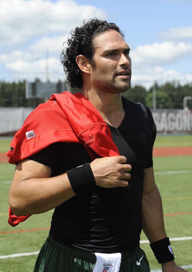 New York Jets quarterback Mark Sanchez leaves the field after practice at NFL football training camp Friday, July 26, 2013, in Cortland, N.Y. (AP Photo/Bill Kostroun)