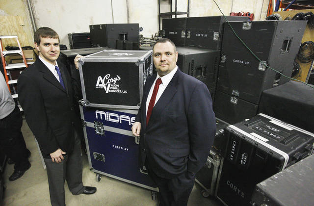 John Cory and Brad Poarch, co-owners of Cory�s Audio Visual Services, with cases of audio and lighting equipment. Photo by Paul B. Southerland, The Oklahoman