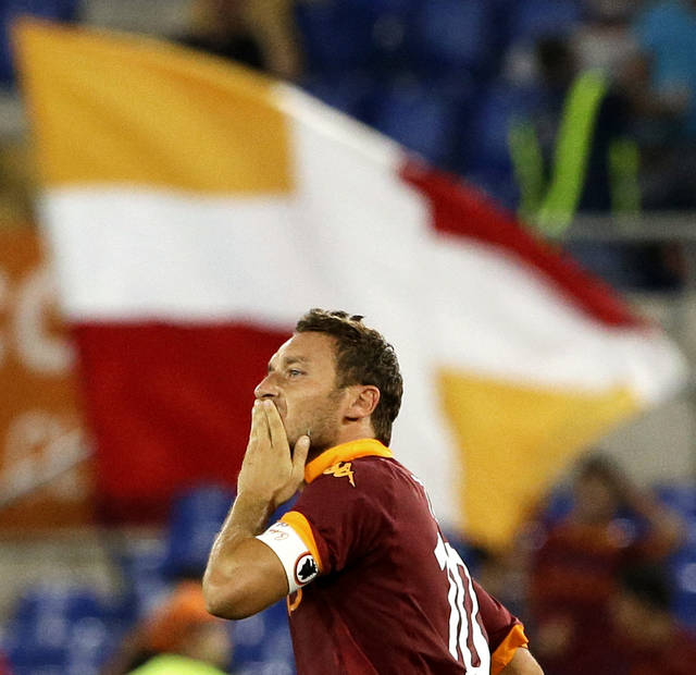 AS Roma's Francesco Totti celebrates after scoring during a Serie A soccer match between AS Roma and Sampdoria at Rome's Olympic stadium, Wednesday, Sept. 26, 2012. (AP Photo/Gregorio Borgia)