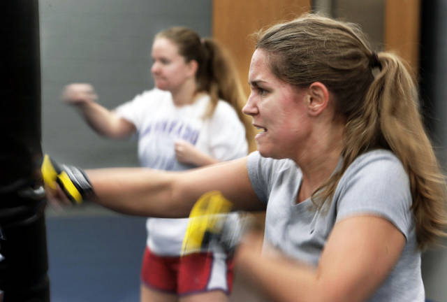 Roxie Hites works out Tuesday during a kickboxing class  at Huston Huffman on the campus of the University of Oklahoma in Norman.