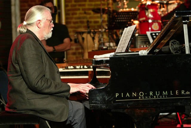 FILE - In this file picture dated Tuesday, Oct. 5, 2004 British musician Jon Lord, plays piano during a test run for his concert in Cologne, western Germany. Deep Purple's Jon Lord, who has died aged 71, Monday, July 16, 2012. The Leicester-born keyboard player, who had pancreatic cancer, died in London today. (AP Poto/Hermann J. Knippertz,File)