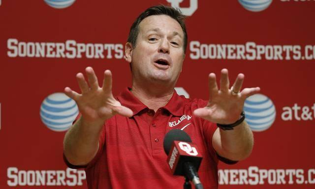 Oklahoma head coach Bob Stoops gestures as he answers a question at a news conference in Norman, Okla., Saturday, Aug. 3, 2013. (AP Photo/Sue Ogrocki)