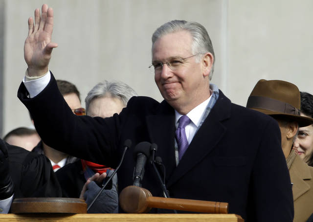 Missouri Gov. Jay Nixon waves after being sworn in to a second term in office Monday, Jan. 14, 2013, in Jefferson City, Mo. (AP Photo/Jeff Roberson)