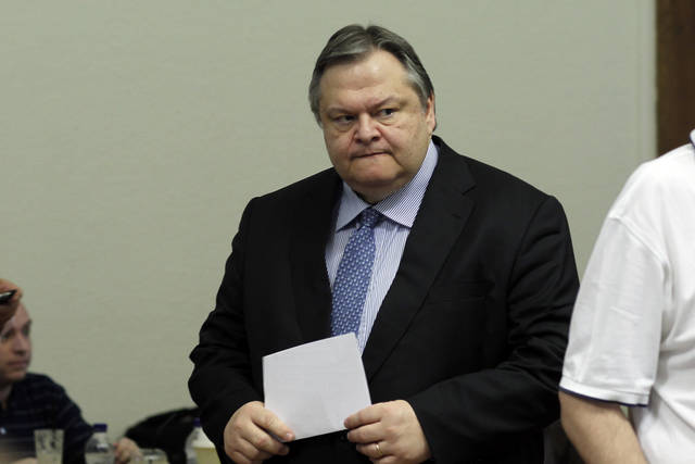 Greek Socialist PASOK party leader Evangelos Venizelos arrives at a press room after a meeting with Democratic Left leader Fotis Kouvelis in the Parliament in Athens, on Tuesday, June 19, 2012. Rival Greek party leaders launched a second day of talks on Tuesday in an attempt to quickly form a pro-bailout coalition government, after the debt-crippled country's second inconclusive election in six weeks. Antonis Samaras' New Democracy party came first in Sunday's vote, winning 129 of Parliament's 300 seats — not enough for him to govern alone. He is seeking an alliance with the third-placed Socialist PASOK and the smaller Democratic Left party. (AP Photo/Kostas Tsironis)