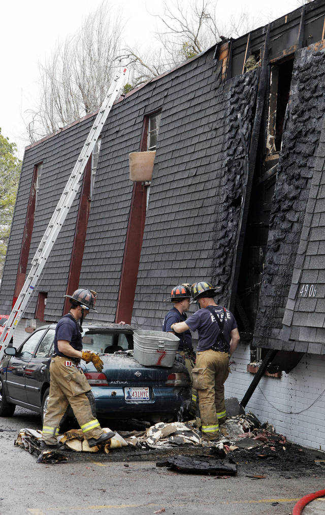 Oklahoma City firemen work the scene Friday of a fatality fire at the Greystone Apartments, 4900 S Walker Avenue, in Oklahoma City. Photo by Paul B. Southerland, The Oklahoman <strong>PAUL B. SOUTHERLAND - PAUL B. SOUTHERLAND</strong>