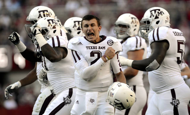 Texas A&M quarterback Johnny Manziel (2) celebrates after a review proves an Aggie touchdown during the first half of their first SEC meeting against and Alabama in an NCAA college football game, Saturday, Nov. 10, 2012, in Tuscaloosa, Ala. No. 15 Texas A&M defeated No. 1 Alabama 29-24.  (AP Photo/The Decatur Daily, Gary Cosby Jr.) ORG XMIT: ALDEC101