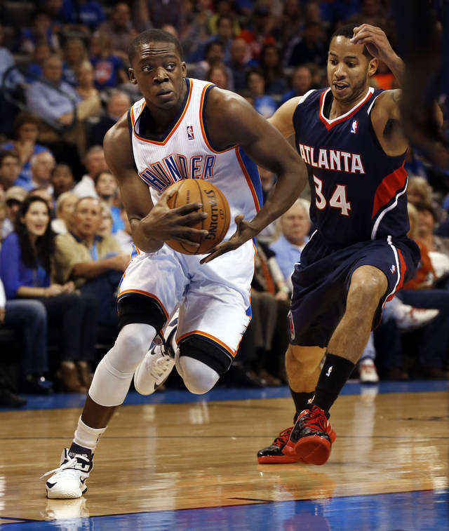 Oklahoma City Thunder's Reggie Jackson (15) drives in front of Atlanta Hawk's Devin Harris (34) as the Oklahoma City Thunder play the Atlanta Hawks in NBA basketball at the Chesapeake Energy Arena in Oklahoma City, on Sunday, Nov. 4, 2012.  Photo by Steve Sisney, The Oklahoman