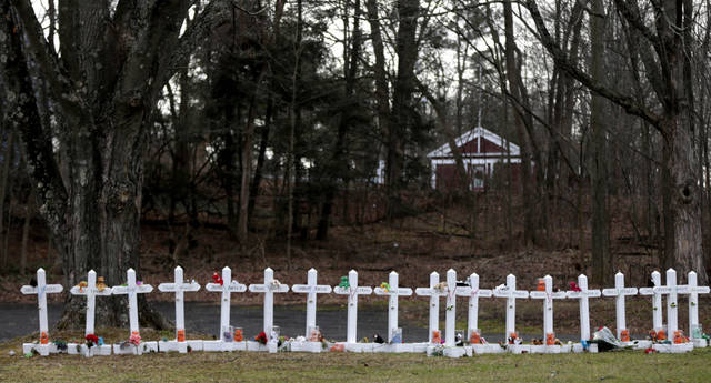 Crosses bearing the names of the Newtown shooting victims are displayed in the Sandy Hook village of Newtown, Conn., Saturday, Dec. 22, 2012. The funerals for the victims of the school shooting are wrapping up after a wrenching week of farewells. Twenty children and six adults were killed at Sandy Hook Elementary School on Dec. 14.  Adam Lanza, the lone gunman, killed his mother before going on the rampage and then committed suicide. (AP Photo/Seth Wenig) ORG XMIT: CTSW103