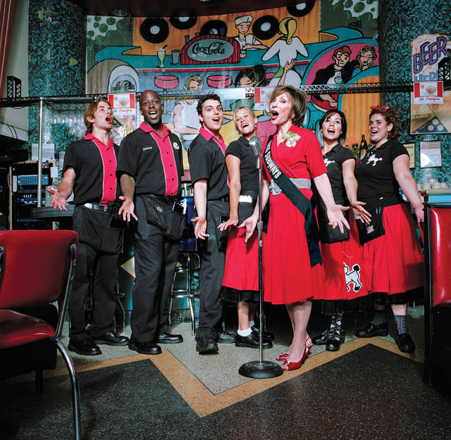 "This 2007 photo provided by Fiona Gardner shows Ellen Hart Sturm, third from right, singing at her restaurant, Ellen's Stardust Diner, on Broadway in New York. Sturm appeared on placards in the New York City subways during March and April of 1959 in the �Meet Miss Subways� campaign that ran for 35 years as eye candy to bring attention to other advertisements in New York�s transit system. ""Meet Miss Subways: New York's Beauty Queens 1941-76,"" is now an exhibition at the New York Transit Museum running Oct. 23-March 25, and a companion book of the same name with current-day photos of the women by photographer Fiona Gardner. (AP Photo/Fiona Gardner)"