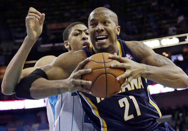 Indiana power forward David West (21) goes to the basket as New Orleans power forward Anthony Davis (23) defends in the first half of a NBA basketball game at the New Orleans Arena in New Orleans Saturday, Dec. 22, 2012. (AP Photo/Dave Martin