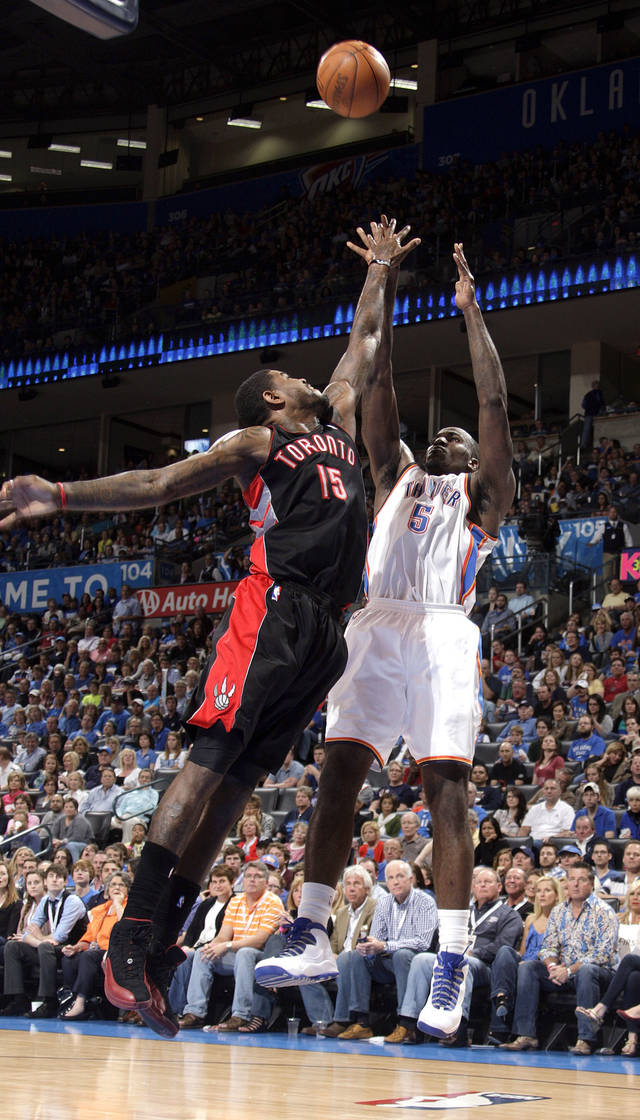 Oklahoma City's Kendrick Perkins (5) shoots over Toronto's Amir Johnson (15) during the NBA basketball game between the Oklahoma City Thunder and the Toronto Raptors at Chesapeake Energy Arena in Oklahoma City, Sunday, April 8, 2012. Photo by Sarah Phipps, The Oklahoman.