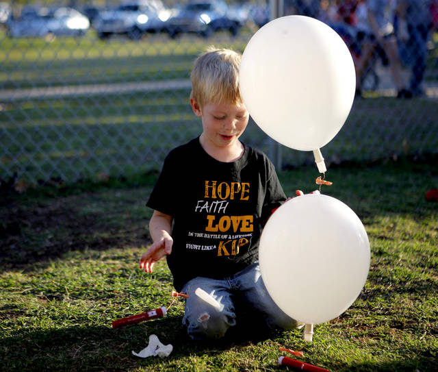Joseph Bailey, 5, helps organize balloons for the Leukemia and Lymphoma Society's Light the Night Walk.