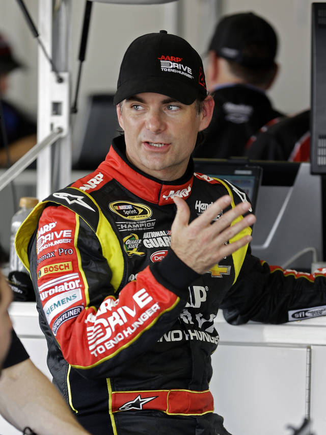 Jeff Gordon talks with crew members in his garage during NASCAR auto race testing at Daytona International Speedway, Thursday, Jan. 10, 2013, in Daytona Beach, Fla. (AP Photo/John Raoux)