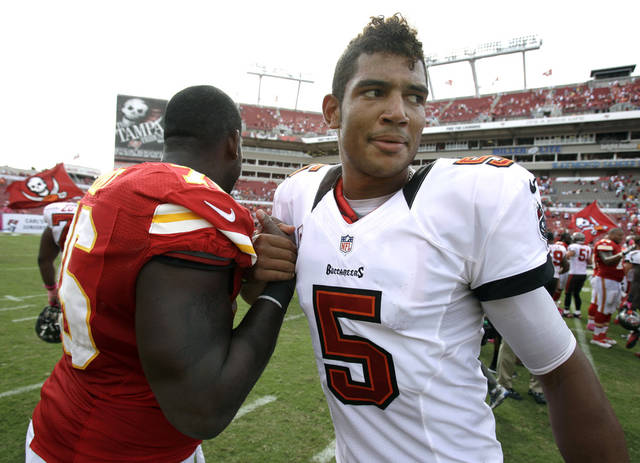 Tampa Bay Buccaneers quarterback Josh Freeman (5) shakes hands with Kansas City Chiefs tackle Branden Albert (76) after an NFL football game on Sunday, Oct. 14, 2012, in Tampa, Fla. Tampa Bay won 38-10. (AP Photo/John Raoux)
