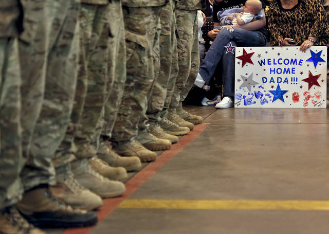 45th Infantry Brigade Combat Team troops are welcomed home by family and friends during the return ceremony for more than 200 National Guard troops at the National Guard Base on Monday, March 12, 2012, in Oklahoma City, Oklahoma.  Photo by Chris Landsberger, The Oklahoman