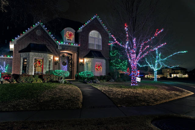 Christmas lights illuminate 4701 Flint Ridge Circle on Thursday, Dec. 22, 2011, in Norman, Okla.   Photo by Steve Sisney, The Oklahoman