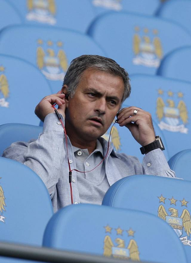 Real Madrid coach Jose Mourinho takes his seat before Manchester City's English Premier League soccer match against Queens Park Rangers at The Etihad Stadium, Manchester, England, Saturday, Sept. 1, 2012. (AP Photo/Jon Super)