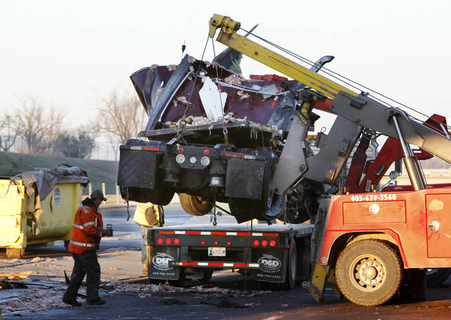 TRUCK / INTERSTATE 40 / ACCIDENT: A wrecker crew lifts a semi cab onto a trailer in the westbound lanes of I-40 at Douglas Boulevard in Oklahoma City Wednesday, Dec. 21, 2011. Photo by Paul B. Southerland, The Oklahoman ORG XMIT: KOD